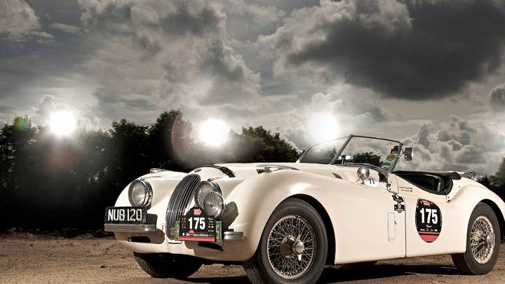 Jaguar XK120 Side Front Pose In White