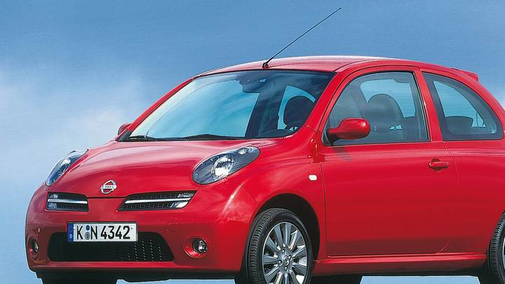Nissan Micra In Red Front Side Pose At 25th Anniversary