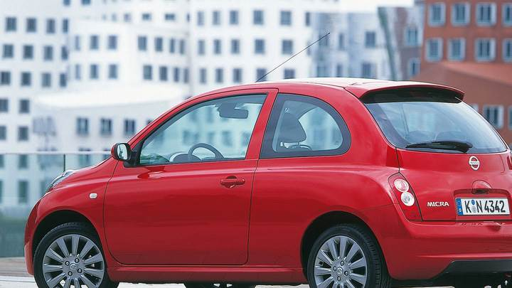 Nissan Micra Side Pose In Red At 25th Anniversary