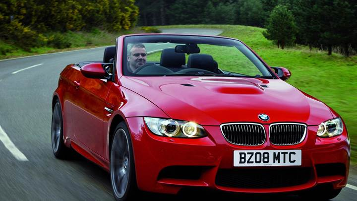 Running 2008 Bmw M3 Convertible In Red Front Pose Wallpaper