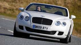 Running 2009 Bentley Continental GTC Speed In White Front Pose
