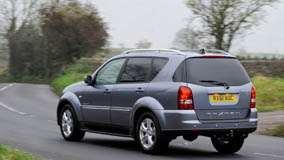 Running 2012 SsangYong Rexton In Grey Back Pose