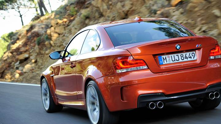 Running Back Pose Of BMW 1 Series M in Orange