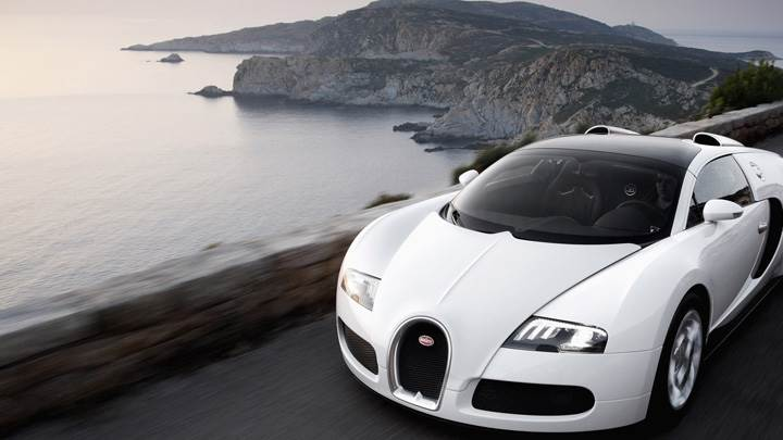 Running Fast Bugatti Veyron 16.4 Grand Sport Near Sea Side In White