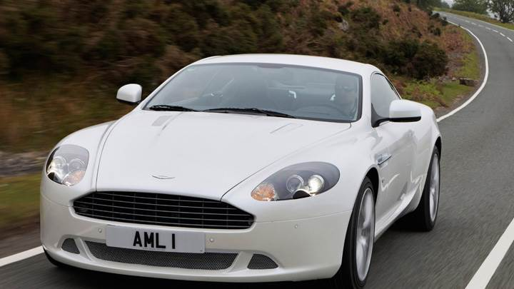 Running Front Pose Of 2010 Aston Martin DB9 In White