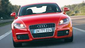 Running Front Pose Of Audi TT Coupe In Red