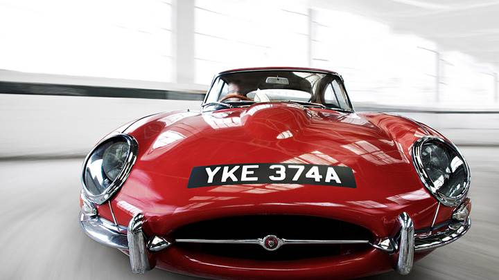 Running Front Pose Of Jaguar E Type Coupe In Red