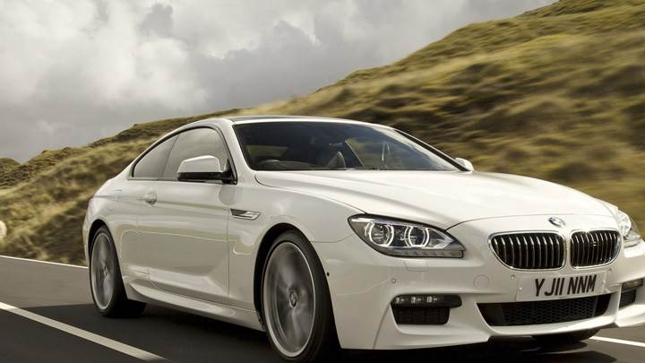 Running Near Hill Station 2012 BMW 6 Series Coupe In White