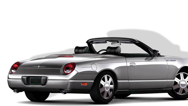 Side Back Pose Of 2005 Ford Thunderbird In Silver N White Background