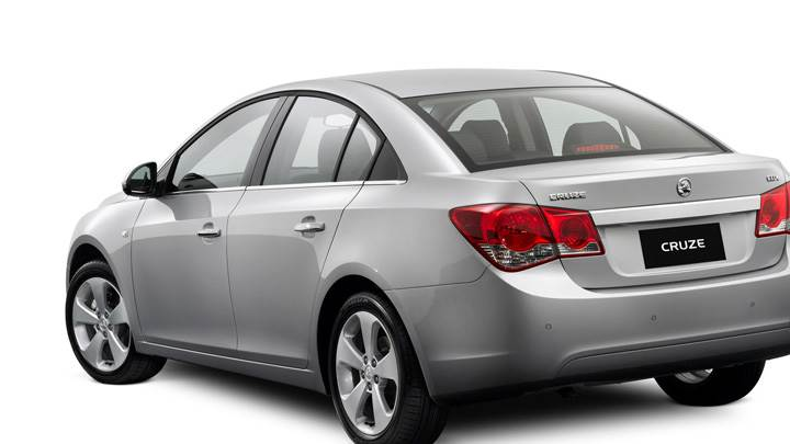 Side Back Pose Of 2009 Holden Cruze CDX In Grey