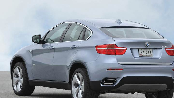 Side Back Pose Of 2010 BMW ActiveHybrid X6 In Silver
