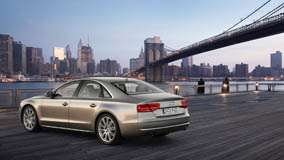 Side Back Pose Of 2011 Audi A8 In Golden