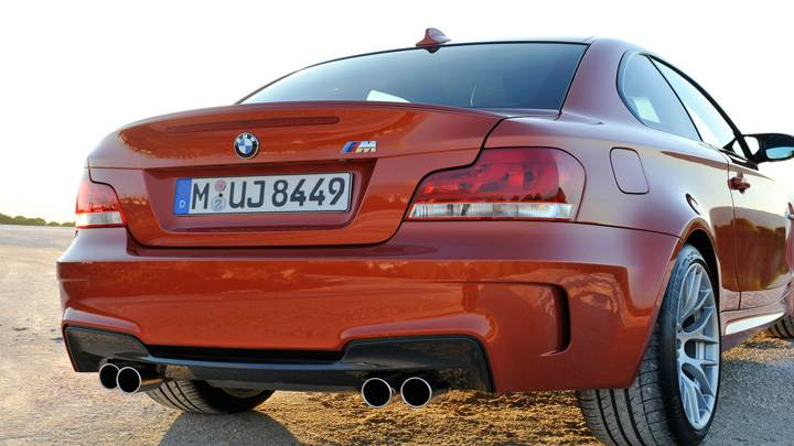 Side Back Pose Of 2011 BMW 1 Series M in Orange