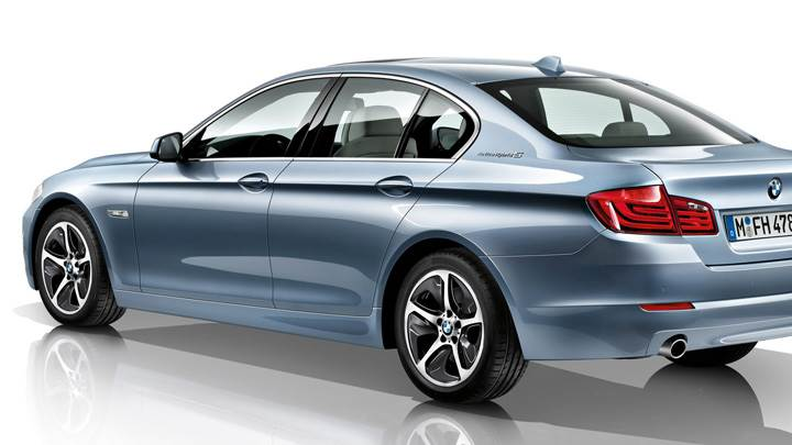 Side Back Pose Of 2012 BMW 3 Series Sedan F30 And White Background