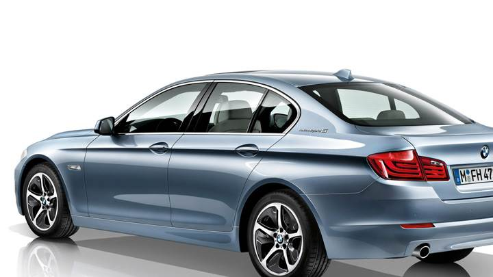Side Back Pose Of 2012 BMW ActiveHybrid 5 And White Background