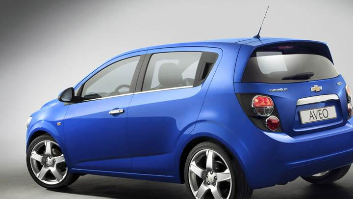 Side Back Pose Of 2012 Chevy Aveo In Blue
