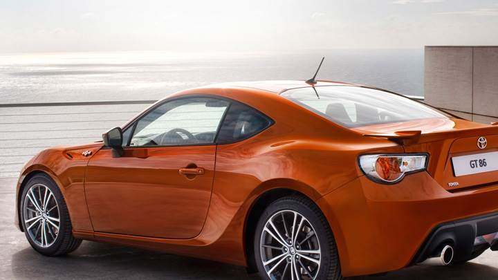 Side Back Pose Of 2012 Toyota GT 86 In Orange