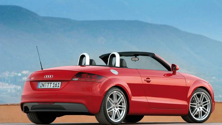 Side Back Pose Of Audi TT Roadster In Red Near Mountains