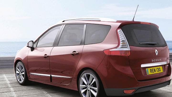 Side Back Pose Of Renault Scenic UK In Red
