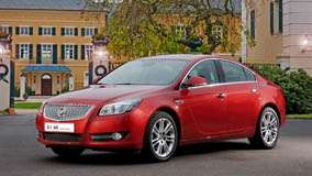 Side Front Pose Of 2008 Buick Regal 2.0 Turbo In Red