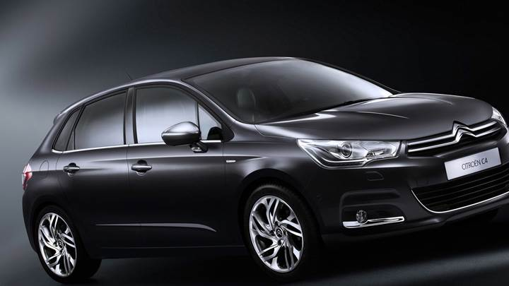 Side Front Pose Of 2011 Citroen C4 In Black N Black Background