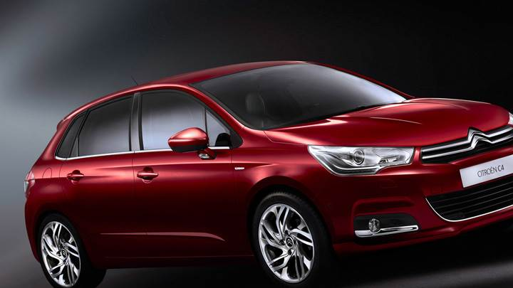Side Front Pose Of 2011 Citroen C4 In Red N Black Background