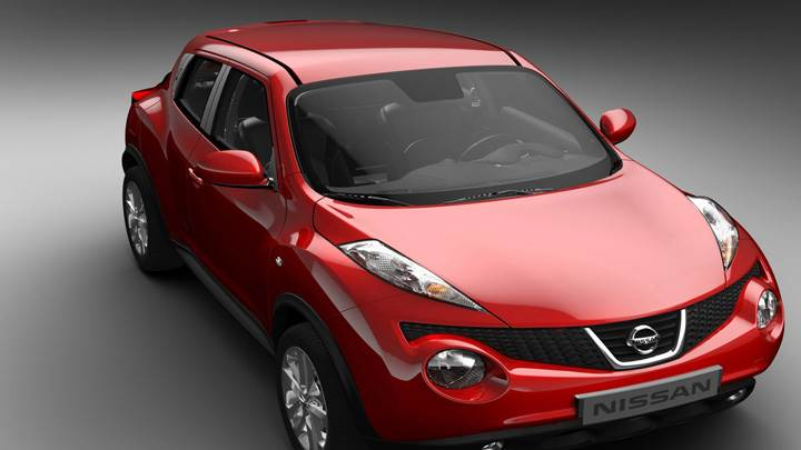 Side Front Pose Of 2011 Nissan Juke In Red