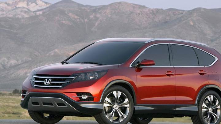 Side Front Pose Of 2012 Honda CR-V Concept Near Mountains In Red