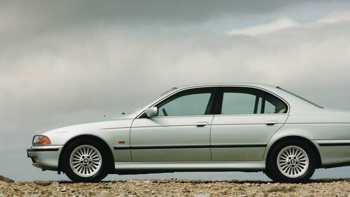 Side Pose Of 1996 BMW 540i In White