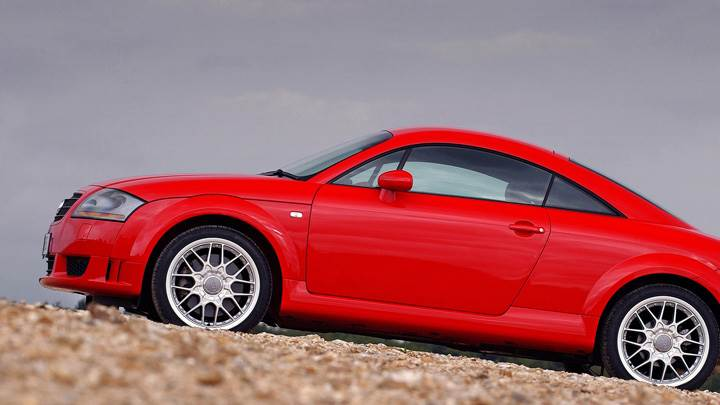 Side Pose Of 2003 Audi TT Coupe In Red