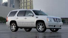 Side Pose Of 2009 Cadillac Escalade Hybrid in White