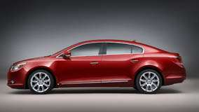 Side Pose Of 2010 Buick LaCrosse CXS In Red N Grey Background