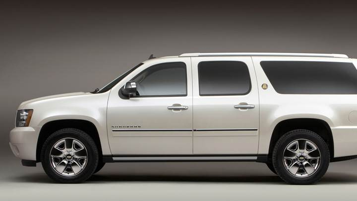 Side Pose Of 2010 Chevrolet Suburban 75th Anniversary Diamond Edition In White