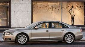 Side Pose Of 2011 Audi A8 In Golden