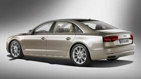 Side Pose Of 2011 Audi A8 L W12 Quattro In Golden