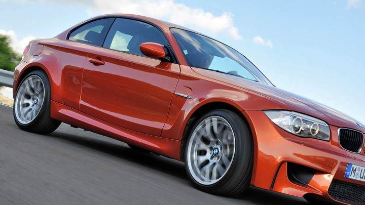 Side Pose Of 2011 BMW 1 Series M Runing in Orange