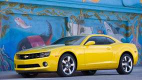 Side Pose Of 2011 Chevrolet Camaro in Yellow
