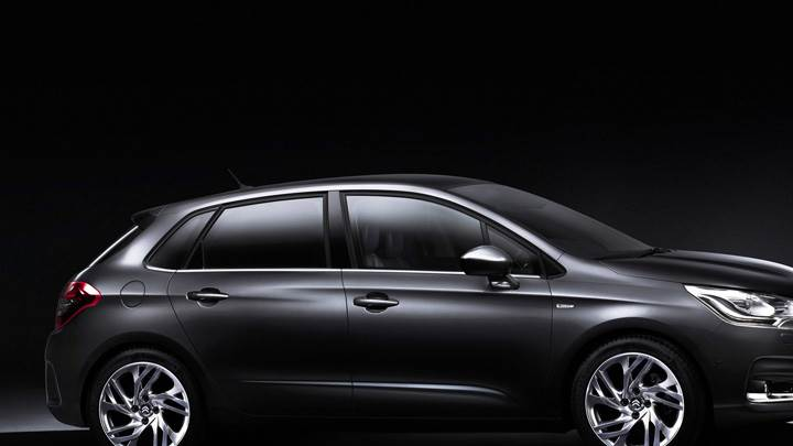 Side Pose Of 2011 Citroen C4 In Black N Black Backround