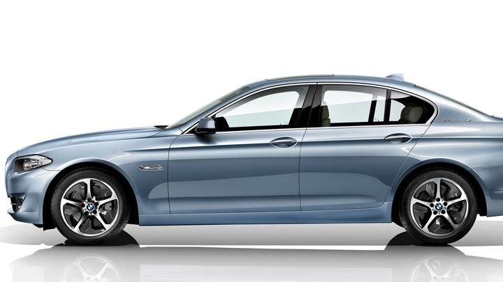 Side Pose Of 2012 BMW 3 Series Sedan F30 And White Background