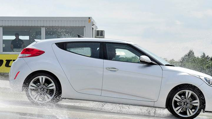 Side Pose Of 2012 Hyundai Veloster Coupe In White