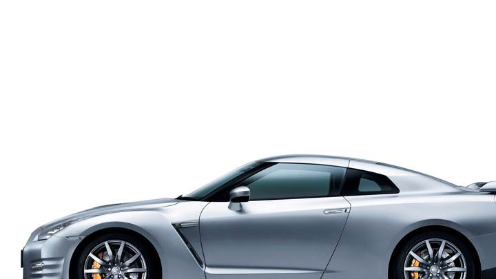 Side Pose Of 2012 Nissan GT-R In Silver N White Background