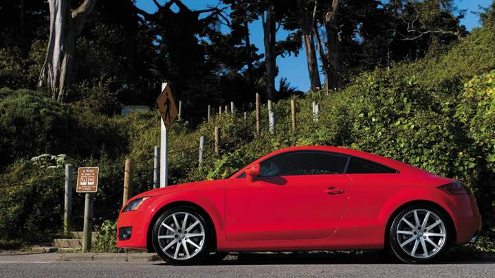 Side Pose Of Audi TT Coupe In Red