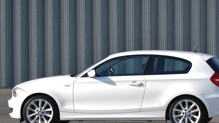 Side Pose Of BMW 1 Series 3 Door In White