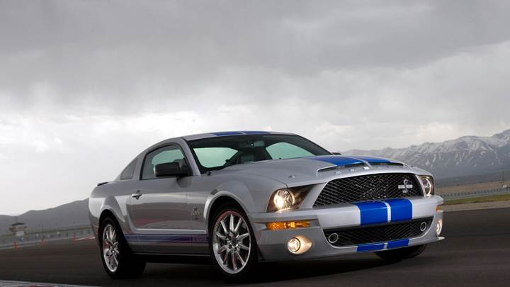 Side Pose of 2008 Ford Shelby GT500KR In Silver On Racing Track