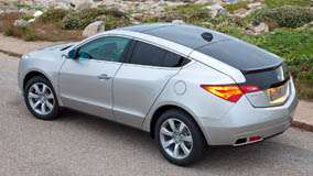 Side Pose of 2010 Acura ZDX In Silver