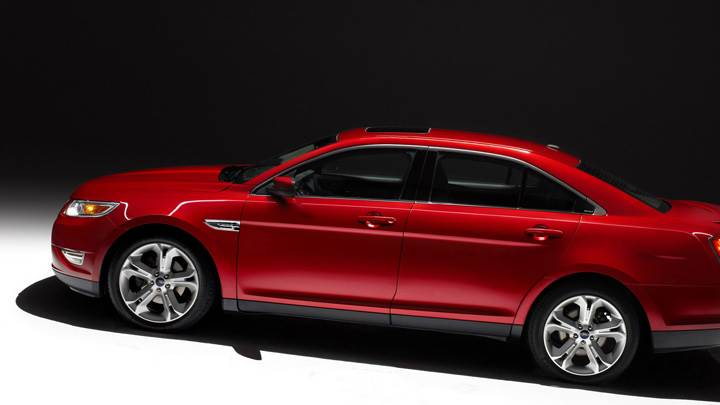 Side Pose of 2010 Ford Taurus SHO In Red