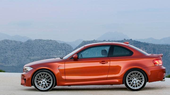 Side Pose of 2011 BMW 1 Series M Near Moutains
