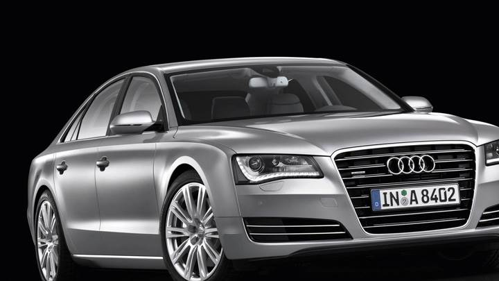 Side pose Of 2011 Audi A8 In Silver And Black Background
