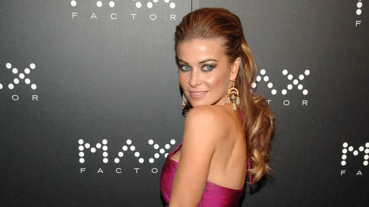 Smiling Side Modeling Pose Of Carmen Electra In Pink Dress