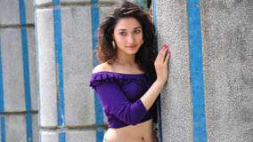 Tamanna Bhatia In Purple Dress N Pink Lips in Vengai Movie